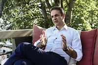 Greece's opposition New Democracy leader Kyriakos Mitsotakis gives an interview to AFP journalists at a hotel near the central Greek city of Volos on July 2, 2019, during his pre-election campaign five days ahead of the general elections. - Greeks vote on July 7, 2019 in a general election that is the first in the country's post-bailout era, which looks set to oust leftist Prime Minister Alexis Tsipras after a record-setting four years in power. (Photo by ARIS MESSINIS / AFP)
