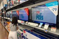 Chinese made televisions for sale at a store after US import tariffs rose more on $100 billion in Chinese goods over the weekend, in Los Angeles, California on September 3, 2019. - US President Donald Trump has warned Beijing not to drag its feet in trade negotiations in hopes of a better deal if he is voted out of office next year. (Photo by Mark RALSTON / AFP)
