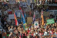 Protesters leave Civic Square as they march to Parliament during a climate strike protest march in Wellington on September 27, 2019. - More than 40,000 people packed into the grounds of Wellington's parliament buildings on September 27, giving the latest global climate strike a flying start with the largest turnout yet seen in New Zealand. (Photo by Marty MELVILLE / AFP)
