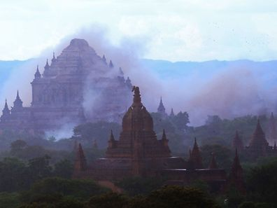 The ancient Dhammayangyi temple is seen shrouded in dust as a 6.8 magnitude earthquake hit Bagan on August 24.