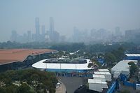 A general view is seen with the city skyline shielded by the smoke haze during an Australian Open practise session at Melbourne Park in Melbourne, Tuesday, January 14, 2020. (AAP Image/Michael Dodge) NO ARCHIVING, EDITORIAL USE ONLY