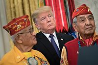 US President Donald Trump listens with Navajo Code Talkers in the Oval Office of the White House during an event to honor Native American code talkers who served in World War II November 27, 2017 in Washington, DC. / AFP PHOTO / Brendan Smialowski