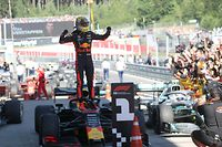 Red Bull Racing's Dutch driver Max Verstappen celebrates winning the Austrian Formula One Grand Prix in Spielberg on June 30, 2019. - Max Verstappen won the Austrian Grand Prix after overtaking Charles Leclerc's Ferrari in the closing laps with the stewards announcing an inquiry into the manoeuvre. (Photo by GEORG HOCHMUTH / APA / AFP) / Austria OUT