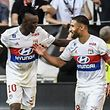 Lyon's Burkinabe forward Bertrand Traore (L) celebrates with Lyon's French forward Nabil Fekir after scoring a goal during the L1 football match Olympique Lyonnais (OL) vs FC Girondins de Bordeaux (FCGB), on August 19, 2017 at the Groupama stadium in D�cines-Charpieu near Lyon, southeastern France. / AFP PHOTO / PHILIPPE DESMAZES