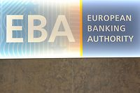 (FILES) This file photo taken on March 23, 2017 shows the European Banking Authority (EBA) logo seen at the EBA offices in London's Canary Wharf financial district. Amsterdam and Paris on November 20, 2017, won the fight to host two major EU agencies when they leave London after Brexit, in a suspenseful vote that eventually had to be decided by the drawing of lots. The European Medicines Agency will relocate to the Dutch city, while the French capital will be the new home of the European Banking Authority.  / AFP PHOTO / Alice DORE