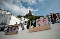 A man stands next to election posters in Zahara De la Sierra near Cadiz on November10, 2019 during general elections in Spain . - Spain holds its fourth election in as many years today, following weeks of political turbulence and violent clashes between Catalan separatists and police, and the long-awaited exhumation of Franco's remains. Polls suggest Prime Minister Pedro Sanchez's Socialists will once again win the most seats in parliament but fall short of a majority, meaning they will have to form alliances with other parties in order to govern. (Photo by JORGE GUERRERO / AFP)