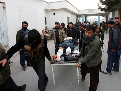 Men carry an injured police officer to a hospital after a suicide attack in Kabul, Afghanistan January 10, 2017. REUTERS/Mohammad Ismail