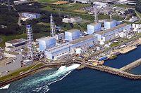 """ARCHIV - 11.03.2011, Japan, Fukushima: HANDOUT - Die Luftaufnahme des Betreibers Tepco zeigt das japanische Atomkraftwerk in Fukushima am 11.03.2011. (zu dpa """"Japans Atomaufsicht gibt grünes Licht für jahrzehntealten Reaktor"""" vom 26.09.2018) Foto: The Tokyo Electric Power Company/EPA/TEPCO/dpa - ACHTUNG: Nur zur redaktionellen Verwendung und nur mit vollständiger Nennung des vorstehenden Credits +++ dpa-Bildfunk +++"""