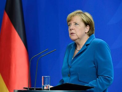 (FILES) This file photo taken on July 23, 2016 shows German Chancellor Angela Merkel giving a press conference at the Chancellery in Berlin, one day after the attack at the shopping centre in Munich, southern Germany. Four brutal assaults in the south of the country, three of which were carried out by asylum seekers, have rattled Germans and revived a backlash against Merkel's decision last year to open the borders to those fleeing war and persecution.  / AFP PHOTO / TOBIAS SCHWARZ