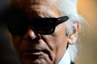 (FILES) In this file photo taken on January 28, 2013 Italian fashion house Fendi's designer Karl Lagerfeld reacts during a press conference announcing Fendi would finance a renovation of the Trevi Fountain in Rome at the Capitoline museums in Rome. - German fashion designer Karl Lagerfeld has died at the age of 85, it was announced on February 19, 2019. (Photo by Gabriel BOUYS / AFP)