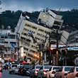A general view shows the Yun Tsui building (back C) leaning to one side after an overnight earthquake in the Taiwanese city of Hualien on February 7, 2018. Rescue workers pulled survivors and bodies from buildings tilting precariously in the Taiwanese city of Hualien on February 7 after an overnight earthquake killed at least six people, injured more than 200 and left dozens missing. Emergency responders were focusing on a 12-storey apartment block and a nearby hotel, both of which were leaning dangerously with their lower floors pancaked after the 6.4-magnitude quake hit the popular tourist city late Tuesday.  / AFP PHOTO / Anthony WALLACE