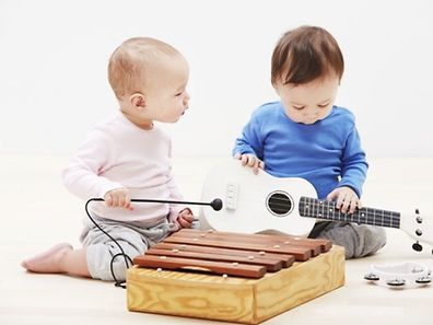 US researchers compared nine-month-old babies who played with toys and trucks to those who practiced banging out a rhythm during a series of play sessions.