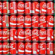 (FILES) This file photo taken on February 9, 2017 shows pallets of Coke-Cola cans waiting to the filled at a Coco-Cola bottling plant  in Salt Lake City, Utah.  Coca-Cola saw profits drop sharply due to sales of bottling facilities as it moved to expand offerings of low-sugar and non-carbonated beverages amid flagging demand for sweet sodas, the company said on July 26, 2017. Net income for the US soft drinks giant plunged 60 percent in the second quarter to $1.4 billion, while revenues fell 16 percent to $9.7 billion. Both were hit by the company's move to offload bottling assets in North America. / AFP PHOTO / GETTY IMAGES NORTH AMERICA / GEORGE FREY