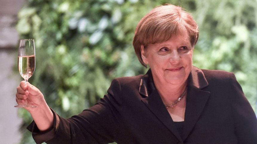 German Chancellor Angela Merkel makes a toast during a state dinner at the Kirchner Cultural Centre in Buenos Aires