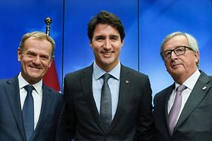(LtoR) European Council President Donald Tusk, Canadian Prime Minister Justin Trudeau and European Commission President Jean-Claude Juncker pose after the joint press conference and the signing of the CETA trade deal during the EU-Canada summit meeting , on October 30, 2016 at the European Union headquarters in Brussels.  After a chaotic drama in which a small Belgian region threatened to sink a giant trade deal seven years in the making, the European Union and Canada will finally sign on the dotted line on October 30. Justin Trudeau agreed at the last minute to fly to Brussels to ink the landmark pact known as CETA at a summit with European Union President Donald Tusk and European Commission head Jean-Claude Juncker.  / AFP PHOTO / JOHN THYS