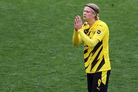 Dortmund's Norwegian forward Erling Braut Haaland reacts after the German first division Bundesliga football match between Borussia Dortmund and Eintracht Frankfurt in Dortmund, western Germany, on April 3, 2021. (Photo by LARS BARON / POOL / AFP) / DFL REGULATIONS PROHIBIT ANY USE OF PHOTOGRAPHS AS IMAGE SEQUENCES AND/OR QUASI-VIDEO