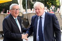 EU Commission president Jean-Claude Juncker (L) shakes hands with British Prime Minister Boris Johnson (R) prior to their meeting, on September 16, 2019 in Luxembourg - Six weeks before he is due to lead Britain out of the European Union, Prime Minister Boris Johnson meets Jean-Claude Juncker, insisting that a Brexit deal is possible. Downing Street has confidently billed the Luxembourg visit as part of efforts to negotiate an orderly divorce from the union before an October 17 EU summit. (Photo by Fran�ois WALSCHAERTS / AFP)