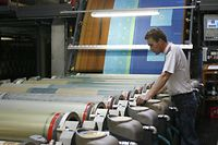 A worker operates textile machines at textile manufacturer Bierbaum Unternehmensgruppe in Borken in this October 25, 2006 file photo. Bierbaum, a manufacturer of bedclothes and cleaning wipes, has had to listen to bankers telling it there is no way the firm should still be manufacturing products in high-cost Germany. But Bierbaum has proved them all wrong, raising productivity to the point where it became more cost-effective to make some goods destined for its main domestic market at home in Germany than in low-cost neighbor Poland. The business is one of a growing number of companies whose rising competitiveness and readiness to invest is expected to help sustain Germany's economic recovery next year. To match feature ECONOMY GERMANY BIERBAUM REUTERS / Ina Fassbender / Files (GERMANY)