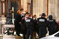 "Opera guests leave the state opera under the supervision of armed policemen, in the center of Vienna on November 2, 2020, following a shooting. - Two people, including one attacker, have been killed in a shooting in central Vienna, police said late November 2, 2020. Vienna police said in a Twitter post there had been ""six different shooting locations"" with ""one deceased person"" and ""several injured"", as well as ""one suspect shot and killed by police officers"". (Photo by Joe Klamar / AFP)"