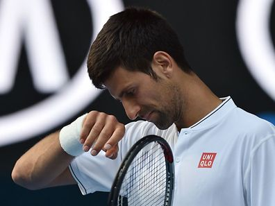 Serbia's Novak Djokovic reacts after a point against Uzbekistan's Denis Istomin during their men's singles second round match on day four of the Australian Open tennis tournament in Melbourne on January 19, 2017. / AFP PHOTO / PAUL CROCK / IMAGE RESTRICTED TO EDITORIAL USE - STRICTLY NO COMMERCIAL USE