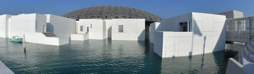"""A general view shows part of the Louvre Abu Dhabi Museum designed by French architect Jean Nouvel on November 7, 2017 on the eve of the official opening of the museum on Saadiyat island in the Emirati capital.  More than a decade in the making, the Louvre Abu Dhabi opens its doors this week, bringing the famed name to the Arab world for the first time. The museum currently has some 300 pieces on loan, including an 1887 self-portrait by Vincent van Gogh and Leonardo da Vinci's """"La Belle Ferronniere"""".  / AFP PHOTO / GIUSEPPE CACACE / RESTRICTED TO EDITORIAL USE - MANDATORY MENTION OF THE ARTIST UPON PUBLICATION - TO ILLUSTRATE THE EVENT AS SPECIFIED IN THE CAPTION"""