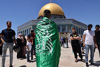 Palestinian Muslim worshippers chant slogans supporting the Islamist movement Hamas flag following Friday prayers in Jerusalem's al-Aqsa mosque compound, the third holiest site of Islam, on May 14, 2021. (Photo by ahmad gharabli / AFP)