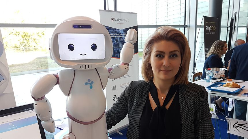 Aida Nazari-khorram with the QT robot, born together with her colleague Pouyan Ziafati.