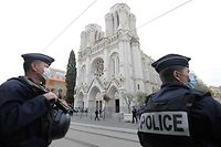 "TOPSHOT - French policemen stand guard the site of a knife attack at the Basilica of Notre-Dame de Nice in Nice on October 29, 2020, as forensics officers prepare to enter. - France's national anti-terror prosecutors said Thursday they have opened a murder inquiry after a man killed three people at a basilica in central Nice and wounded several others. The city's mayor, Christian Estrosi, told journalists at the scene that the assailant, detained shortly afterwards by police, ""kept repeating 'Allahu Akbar' (God is Greater) even while under medication."" He added that President Emmanuel Macron would be arriving shortly in Nice. (Photo by ERIC GAILLARD / AFP)"
