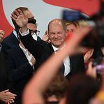 Alemanha. Sociais-democratas reclamam vitória perante mínimo histórico dos conservadores