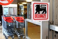 Shopping trolleys are placed to block the entrance of a Delhaize supermarket during a strike in Brussels June 11, 2014. Belgian supermarket chain Delhaize will cut up to 2,500 jobs at its Belgian operations over the next three years, about 15 percent of its workforce there, to restore margins hit by high wage costs and tough competition, it said on Wednesday.  REUTERS/Francois Lenoir (BELGIUM - Tags: BUSINESS EMPLOYMENT LOGO)