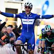 "TOPSHOT - Colombian Alvaro Jose Hodeg of Quick-Step Floors celebrates as he crosses the finish line to win the ""Handzame Classic"", a one day cycling race of 199,1 km, from Bredene to Handzame, Bredene, on March 16, 2018.  / AFP PHOTO / BELGA / DAVID STOCKMAN / Belgium OUT"