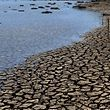 View of the bed of Jacarei river dam, in Piracaia, during a drought affecting Sao Paulo state, Brazil on November 19, 2014. The Jacarei river dam is part of the Sao Paulo's Cantareira system of dams, which supplies water to 45% of the metropolitan region of Sao Paulo --20 million people-- and is now at historic low. AFP PHOTO / NELSON ALMEIDA