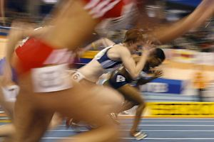 Athletes compete in the heats of the women's 60m semi-final at the 12th IAAF World Indoor Athletics Championship in Valencia March 7, 2008.     REUTERS/Eric Gaillard (SPAIN)
