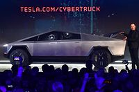 Tesla co-founder and CEO Elon Musk gestures while wrapping up his presentation of the newly unveiled all-electric battery-powered Tesla Cybertruck at Tesla Design Center in Hawthorne, California on November 21, 2019. (Photo by Frederic J. BROWN / AFP)