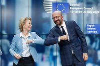 European Commission President Ursula Von Der Leyen (L) and European Council President Charles Michel (R) bump elbows at the end of the news conference following a four days European summit at the European Council in Brussels, Belgium, early July 21, 2020. - EU leaders approved a 750-billion-euro package to revive their coronavirus-ravaged economies after a tough 90-hour summit on July 21, along with a trillion-euro budget for the next seven years. (Photo by STEPHANIE LECOCQ / POOL / AFP)