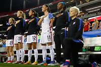 (FILES) In this file photo taken on September 18, 2016 Megan Rapinoe #15 kneels during the National Anthem prior to the match between the United States and the Netherlands at Georgia Dome in Atlanta, Georgia. - The United States Soccer Federation said on June 10, 2020 that it has scrapped a controversial policy banning players from kneeling during the national anthem. In a statement, US Soccer said the rule introduced in 2017 was wrong, and reflected a failure of the federation to address the concerns of black people. (Photo by Kevin C. Cox / GETTY IMAGES NORTH AMERICA / AFP)