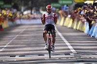 Belgium's Thomas De Gendt celebrates as he wins on the finish line of the eighth stage of the 106th edition of the Tour de France cycling race between Macon and Saint-Etienne, in Saint-Etienne, eastern France, on July 13, 2019. (Photo by Marco Bertorello / AFP)