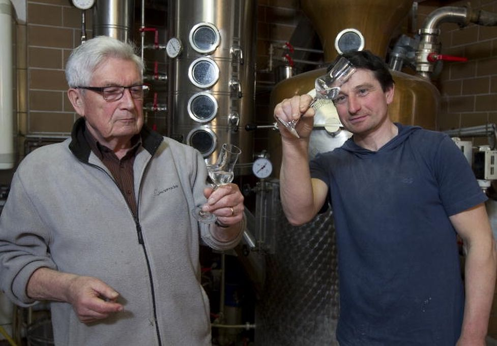 Camille Duhr (right) learned the art of distilling from his father (left), and the craft has been passed down six generations.
