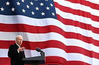 "TOPSHOT - US President-Elect Joe Biden speaks at Major Joseph R. ""Beau"" Biden III National Guard /Reserve Center in New Castle Airport on January 19, 2021, in New Castle, Delaware, before departing for Washington, DC. (Photo by JIM WATSON / AFP)"