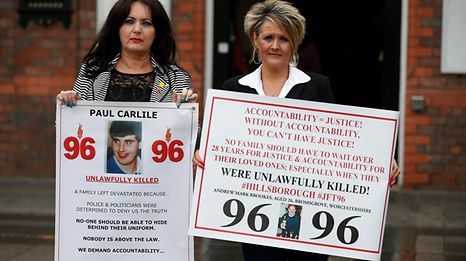 Louise Brooks and Donna Miller campaign for victims of the Hillsborough disaster at Parr Hall in Warrington, Britain.