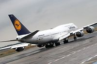 (FILES) In this file photo taken on June 12, 2018 a Boeing 747-8 aircraft of the German airline Lufthansa is pictured at the airport in Frankfurt am Main, western Germany. - Lufthansa has cancelled all flights to and from China on January 29, 2020 amid concerns over the deadly new coronavirus. (Photo by Daniel ROLAND / AFP)