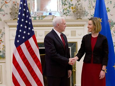 European Union High Representative Federica Mogherini (R) shakes hands with United States Vice President Mike Pence, during a meeting at US ambassadors residence in Brussels on February 20, 2017.