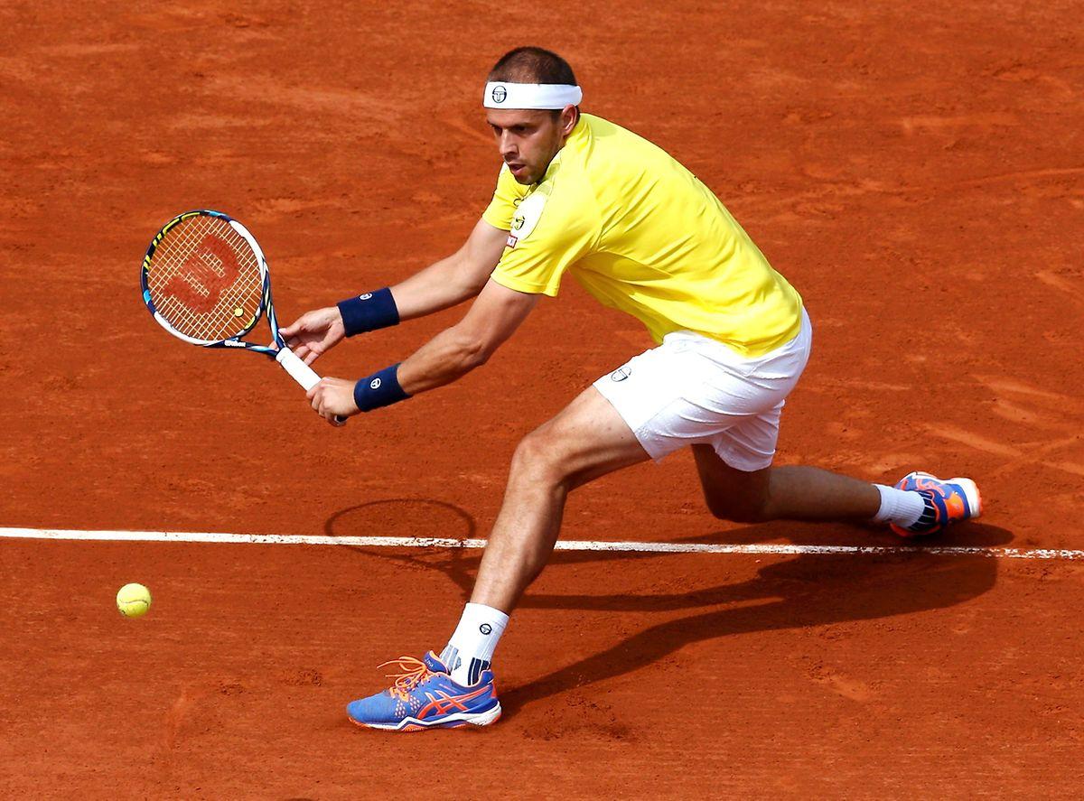 Gilles Muller caiu perante Djokovic,  o número um mundial