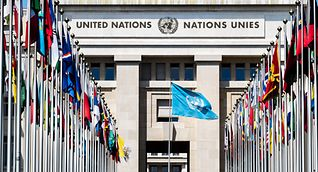 National flags line the entrance to the building in Geneva, Switzerland, that is home to the UN Human Rights Council.