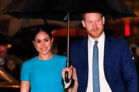 (FILES) In this file photo taken on March 5, 2020 Britain's Prince Harry, Duke of Sussex (R) and Meghan, Duchess of Sussex arrive to attend the Endeavour Fund Awards at Mansion House in London. - Prince Harry and Meghan Markle filed a lawsuit July 23 in Los Angeles against one or more paparazzi whom they accuse of taking pictures of their son without permission, their lawyer told AFP. (Photo by DANIEL LEAL-OLIVAS / AFP)