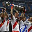 River Plate's goalkeeper Franco Armani celebrates with the trophy after winning the second leg match of the all-Argentine Copa Libertadores final against Boca Juniors, at the Santiago Bernabeu stadium in Madrid, on December 9, 2018. - River Plate came from behind to beat bitter Argentine rivals Boca Juniors 3-1 in extra time. (Photo by Gabriel BOUYS / AFP)
