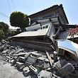 A damaged house is seen in the town of Mashiki, Kumamoto prefecture on April 15, 2016. A strong 6.5-magnitude earthquake hit Japan's southwestern island of Kyushu on Thursday, collapsing homes and sparking fires, officials said, but the scale of damage remained unclear. / AFP PHOTO / KAZUHIRO NOGI