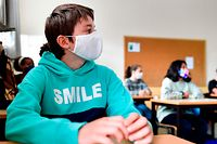 Martin Collinge wearing a protective mask attends a class at the Sacre Coeur de Lindthout secondary school, in Brussels, on September 1, 2020. - Six months after schools closed due to the pandemic, millions of students from France, Belgium or Great Britain make their return to school on September 1, in schools that have had to completely reorganize themselves to avoid the spread of Covid-19. The little French, Belgian and British children open the traditional September ball. Their German, Northern Irish or Scottish peers, in particular, preceded them in August. (Photo by JOHN THYS / AFP)