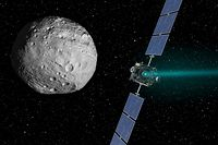 NASA's Dawn spacecraft is pictured in this August 30, 2012 handout artist's rendition of its arrival at the giant asteroid Vesta on July 15, 2011. The spacecraft is scheduled to leave Vesta on September 4 PDT (September 5 EDT) to start its two-and-a-half-year journey to the dwarf planet Ceres. Dawn began its 3-billion-mile (5-billion kilometer) odyssey to explore the two most massive objects in the main asteroid belt in 2007.  REUTERS/NASA/JPL-Caltech/Handout    (UNITED STATES - Tags: SCIENCE TECHNOLOGY) THIS IMAGE HAS BEEN SUPPLIED BY A THIRD PARTY. IT IS DISTRIBUTED, EXACTLY AS RECEIVED BY REUTERS, AS A SERVICE TO CLIENTS. FOR EDITORIAL USE ONLY. NOT FOR SALE FOR MARKETING OR ADVERTISING CAMPAIGNS