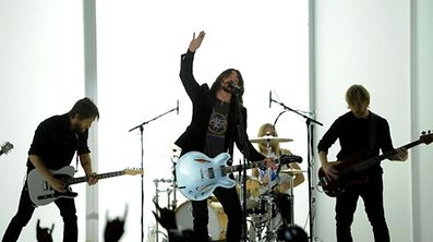 Dave Grohl,center, and the Foo Fighters performs at the 54th annual Grammy Awards on Sunday, Feb. 12, 2012 in Los Angeles. (AP Photo/Chris Pizzello)